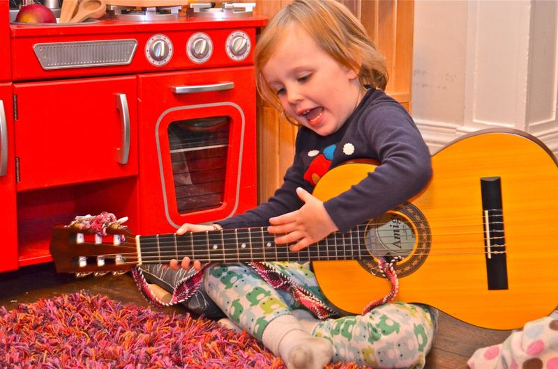 Junebug-singing-guitar-toddler-music