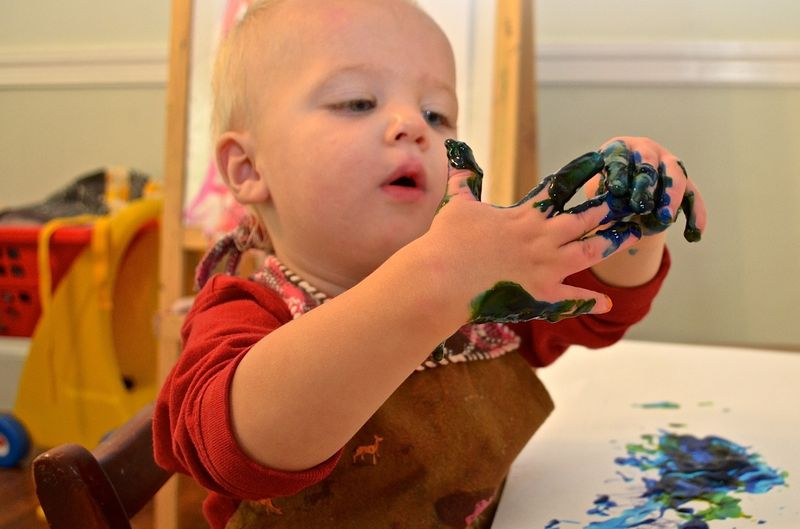 Buddy-boy-hands-fingerpainting-blue