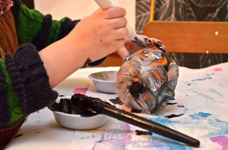 Junebug-pumpkin-painting-hands