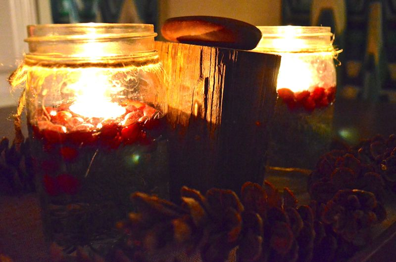 Solstice-centerpiece-cranberries-greens-votive