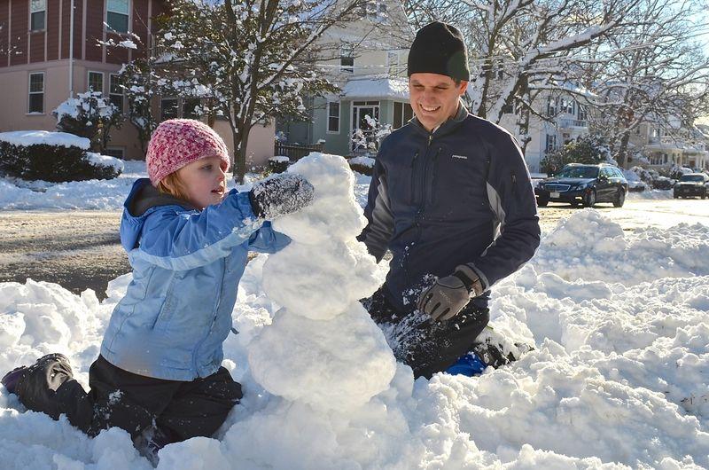 Snowman building junebug daddy